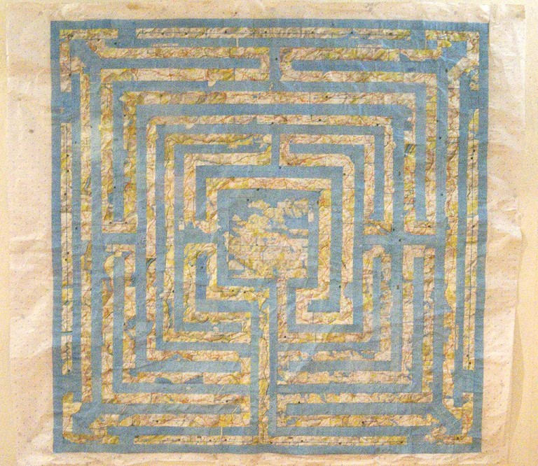 'The Road to Tobemory', a mixed media contemporary artwork by Michelle Rumney in the form of a 7-Circuit Labyrinth, Scottish road atlas pages on paper, photo showing a detail view of the artist's finished unframed work