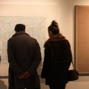 visitors looking at 'Untitled' by artist Michelle Rumney an artwork with a competition to title the piece in the exhibition at Lighthouse Poole