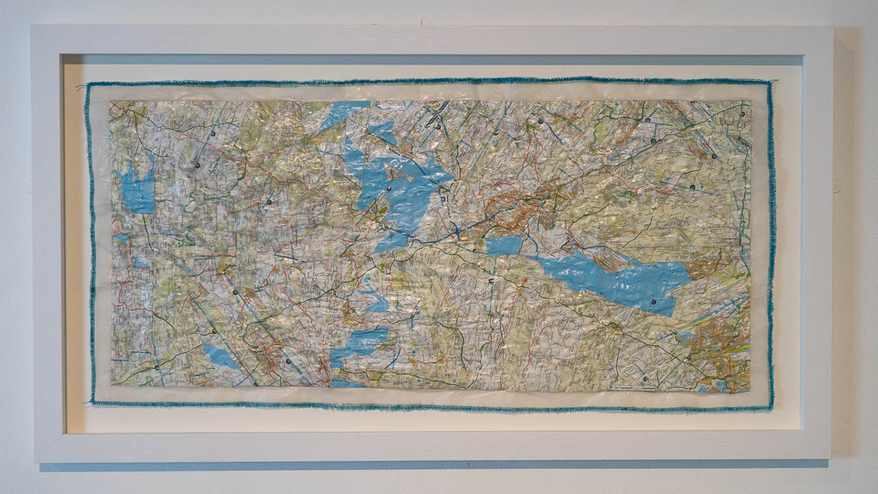 'From Me to You' map pieces and stitching on paper - artwork by Michelle Rumney first shown at Lighthouse Poole's centre for the Arts