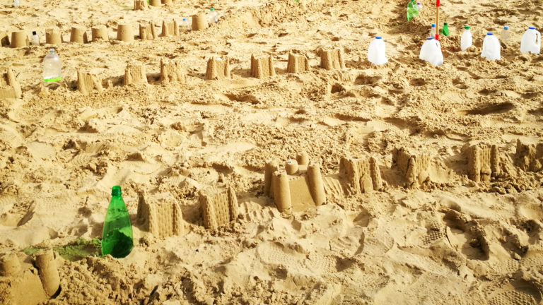 Sandcastles of the Plastic Pathways Beach labyrinth on the sand for Arts by the Sea festival by artist Michelle Rumney