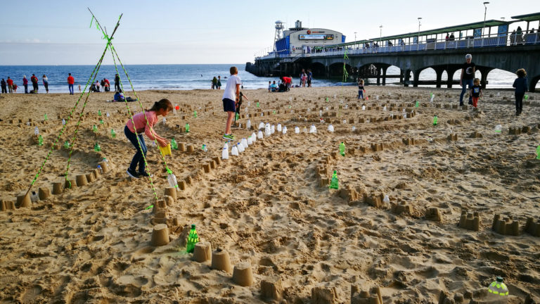 Plastic Pathways Beach labyrinth on the sand for Arts by the Sea festival by artist Michelle Rumney