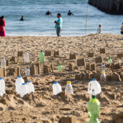 Bottles and Sandcastles of the Plastic Pathways Beach labyrinth on the sand for Arts by the Sea festival by artist Michelle Rumney