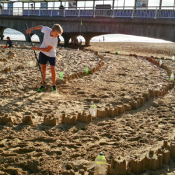 View from the pier of the Plastic Pathways Beach labyrinth on the sand for Arts by the Sea festival by artist Michelle Rumney